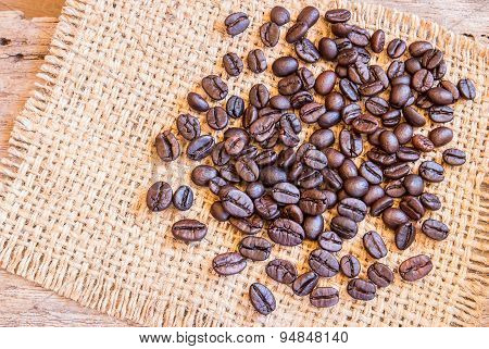 Roasted Coffee Beans On Burlap Sack