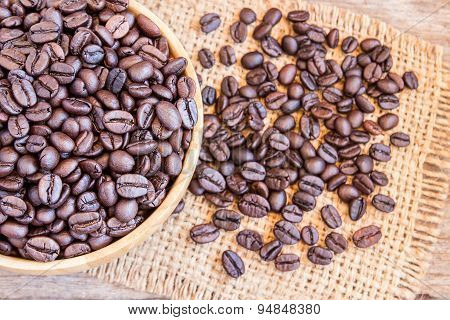 Roasted Coffee Beans In A Wooden Bowl
