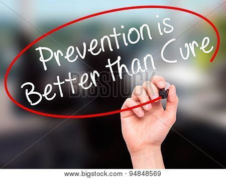 Man Hand writing Prevention is Better than Cure with black marker on visual screen.