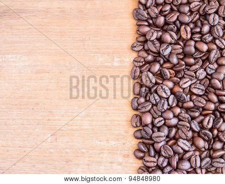 Coffee Beans On Wooden Table Background