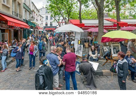 Tourists Visiting Place Du Tertre In Montmartre, Paris, France