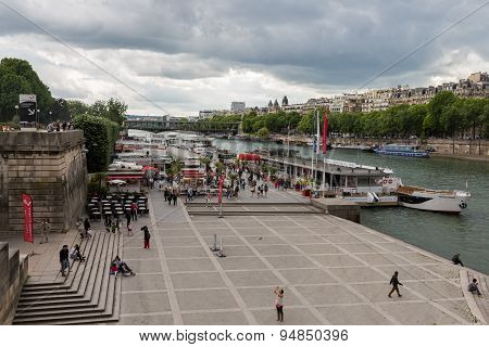 Tourists At Seine Quay With Cruise Ships, Paris France