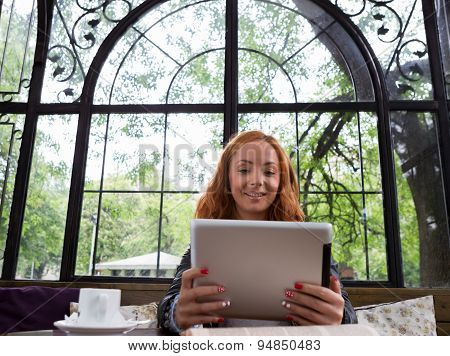 Pretty Girl Posing With A Tablet