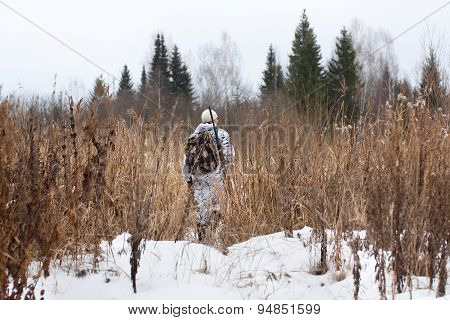 Hunter Walking On The Winter Field