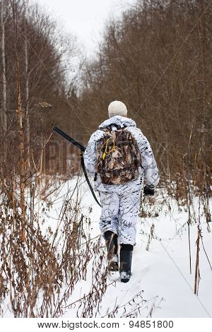 Hunter Walking On The Snowy Glade