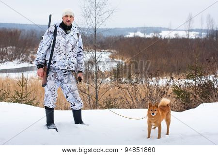 Hunter With His Dog On Winter Hunting