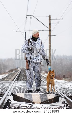 The Hunter With Dog On The Railroad Crossing