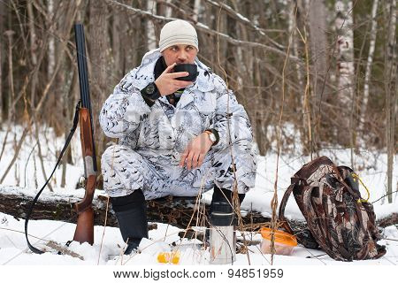 Hunter During The Rest On Winter Hunting