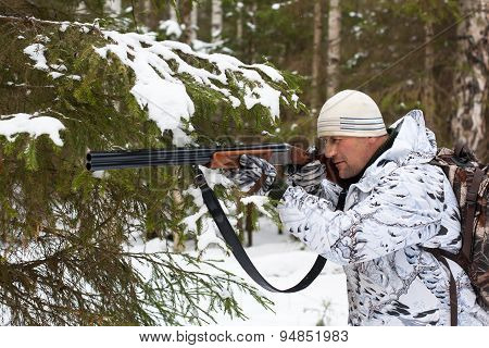 Hunter In Winter Forest