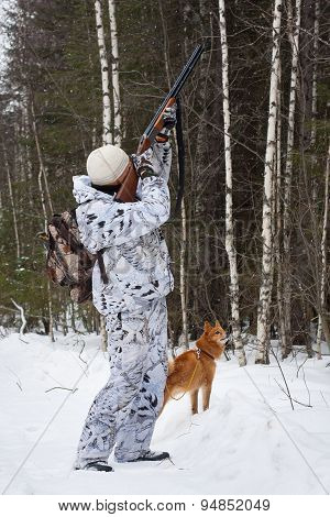 Hunter Shooting In Winter Forest