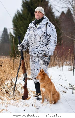 Hunter With Gun And Dog In Winter