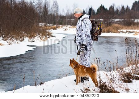 Hunter With His Dog On The River Bank