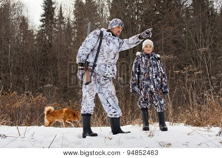 The Hunter With His Son In Winter Forest