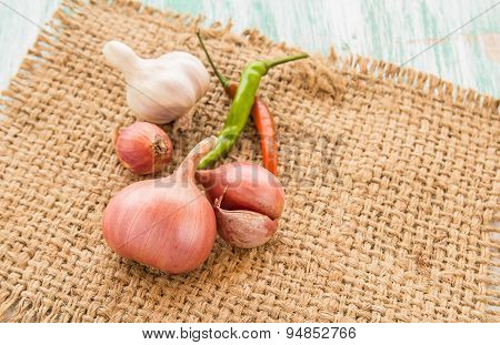 Fresh Organic Red Onion On Burlap Sack