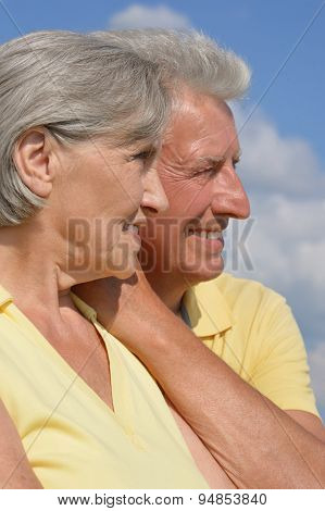 Senior couple on sky background