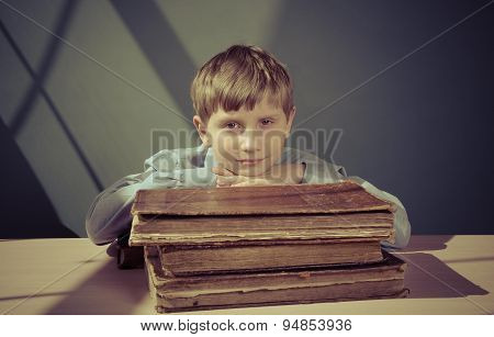 a boy student studying old books