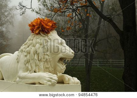 Lion sculpture with garland