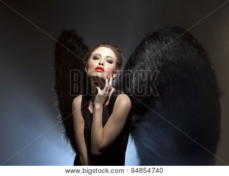 Demoness with languid expression on her face