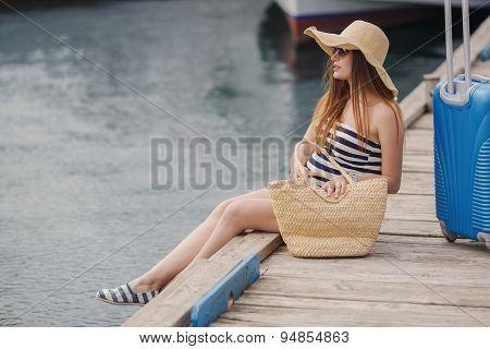 Portrait of beautiful woman on a pier near the sea