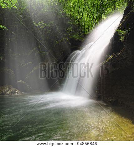 Waterfall Illuminated By Sunshine
