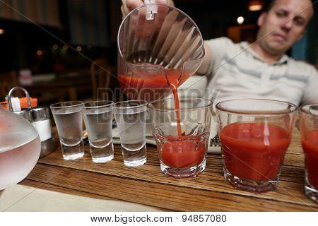 Man Pouring Tomato Juice