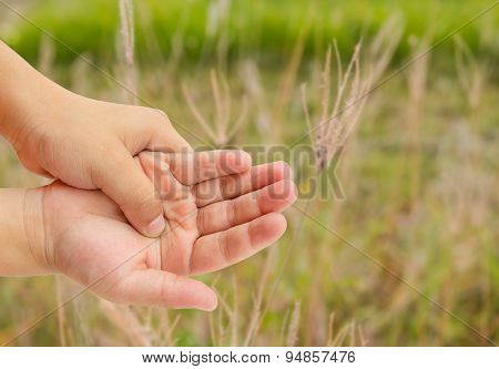 Hand Pain With Blurred Grass Background