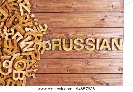 Word russian made with wooden letters