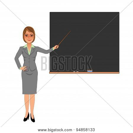 Female teacher pointing at blank blackboard with stick