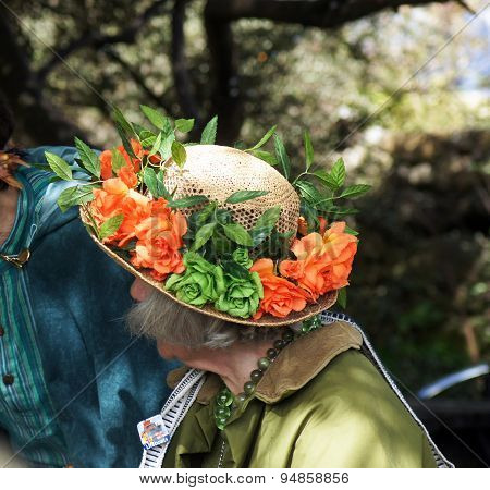 Lady with flower decorated hat