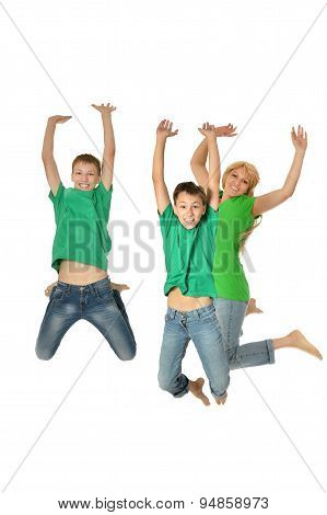 Mother and sons jumping