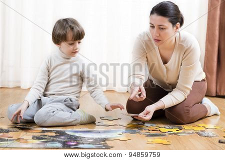 Kid Solving A Puzzle