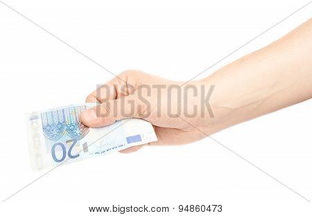 Hand holding twenty euro note isolated