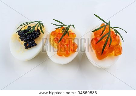 Trout, Salmon And Sturgeon Caviar Served On Quail Eggs