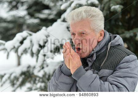 Senior man standing outdoor in winter