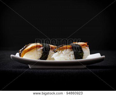 Two Nigiri Eel Sushi On Black Background