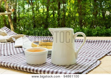 Cookies And Hot Tea In Garden