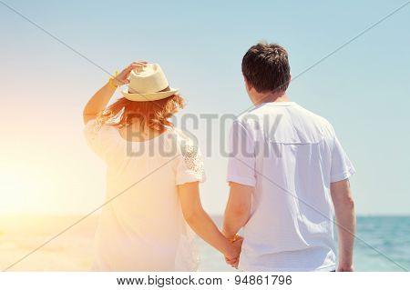 Couple Running On A Sandy Beach