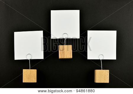 Hierarchy, Three Paper Notes With Holders Black Background For Presentation
