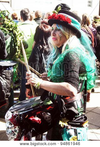 Woman plays drum in carnival