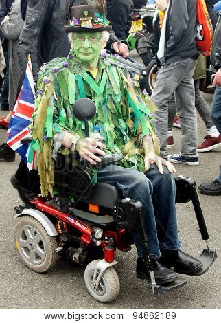 Green faced men on wheelchair