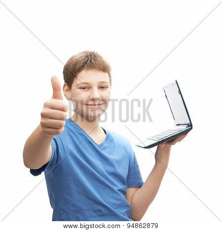 Young boy with a small notebook computer