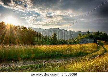 Evening and sunset on mountain hills of Simon village. Bran. Romania