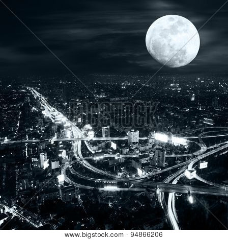 Futuristic Night Panorama Of Bangkok Skyline At Full Moon Night. Thailand