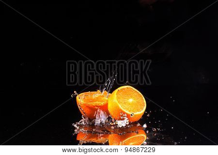 The Orange On A Black Background, Water Flows On Oranges