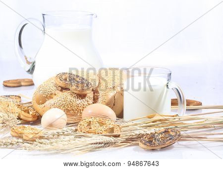 Light Morning Meal: Milk With A Roll And Cookies And An Egg