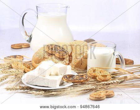 Light Morning Meal: Milk With A Roll And Cookies, Cheese And An Egg