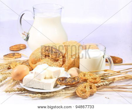 Still-life With Milk In A Transparent Jug, A Roll And A Brynza