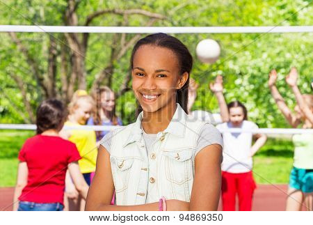 African girl on playground during volleyball game