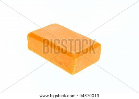 Close Up Bar Of Orange Carrot Soap Isolated On White
