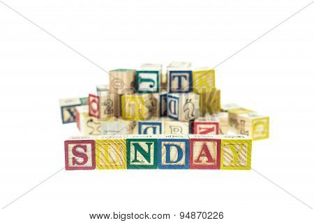 Sunday Written In Letter Colorful Alphabet Blocks Isolated On White